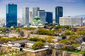 Osaka, Japan city skyline at the castle and business park in the spring.