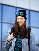 cute brunette real teenage girl in hat, student outside