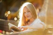 Beautiful Woman Sitting And Reading A Book