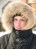 Man In Warm Jacket With Furry Hood poster