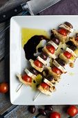 picture of antipasto  - Vegetarian antipasto kepbobs drizzled with olive oil and balsamic vinegar - JPG