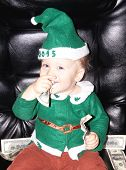 Cute Little Baby Boy And Dollars