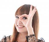 beautiful young woman showing OK sign,