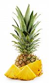 Pineapple with leaves and cut into slices