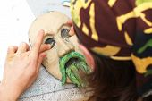 Man Sculpting Plasticine Face With Moustache