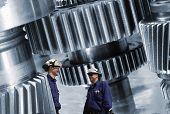 workers, mechanics and large cogwheels machinery, steel industrial.