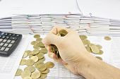 Man Holding Gold Coins