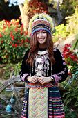foto of hmong  - Traditionally dressed Mhong hill tribe woman in the garden at mountain - JPG