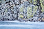 picture of collins  - frozen river and canyon wall covered by lichen  - JPG