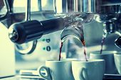 foto of machine  - Preparation of two espresso in coffee machines - JPG