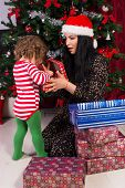 Amazed Mother And Toddler Open Xmas Gifts