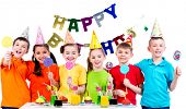 Group of happy kids with colorful candies having fun at the birthday party - isolated on a white.