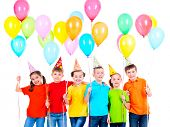 foto of party hats  - Group of smiling children in colored t - JPG