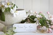 Gift card with apple blossom flowers in vase