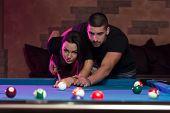 Couple In A Nightclub Playing Pool