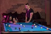 Young Adults Playing Pool