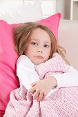 picture of shivering  - Cute ill child shivering in the bed - JPG