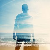 Double Exposure Of Traveler And Sea
