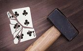Hammer With A Broken Card, Six Of Clubs