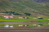stock photo of iceland farm  - Typical Farm Houses at Icelandic Fjord Coast - JPG