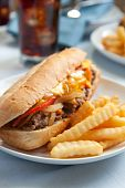 stock photo of cheesesteak  - cheesesteak sandwich accompanied by fries and an ice cold cola - JPG