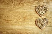 Two beautiful romantic vintage hearts on a wooden oak background. Love and St. Valentines Day concept.