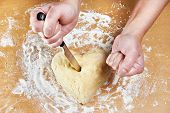 Nervous Woman Pierces Heart Of Dough With Kitchen Knife