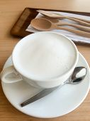 Hot Milk Cup With Spoon And Fork On Table