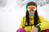 Portrait of pretty girlsitting on snow