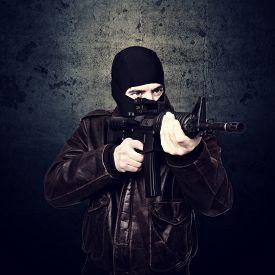 foto of terrorist  - portrait of terrorist and grunge background - JPG