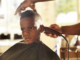 stock photo of shaved head  - little boy getting his head shaved by barber - JPG
