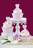 image of marsala  - Wedding June Bride concept with cupcakes and pearls on white shabby chic table and marsala color background - JPG