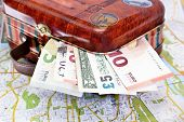 picture of money  - Suitcase with various money Euro Dollar Pound on a map - JPG