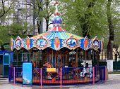 stock photo of carousel horse  - Trade fair carousel children colored toy horses - JPG
