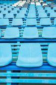 foto of bleachers  - Sport stadium plastic chair on bleachers view row - JPG