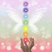stock photo of healing hands  - Healing Hands and seven chakras on a sparkling pastel coloured background - JPG