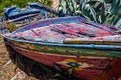 picture of old boat  - Traditional old leaky boat on the coast of Algarve Portugal - JPG
