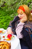 pic of curvaceous  - Beautiful Russian girl with a curvaceous rosy and happy sitting at a table with a samovar drying bagels budlikami strawberries in the spring blooming garden bright colors and spring - JPG