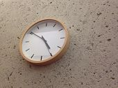 picture of analogy  - Analog white clock on brown stone wall - JPG
