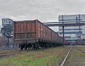 picture of stagnation  - Train under loading of coal at a coal mine - JPG
