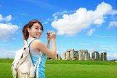 picture of stonehenge  - Happy woman traveler in Stonehenge an ancient prehistoric stone monument UK - JPG