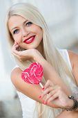 foto of lollipop  - Portrait of a charming long - JPG
