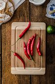 stock photo of chillies  - Chilli peppers raw homemade bread lime simple photo rustical - JPG