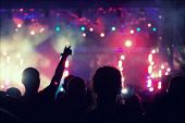 picture of cheers  - Cheering crowd in front of bright colorful stage lights  - JPG
