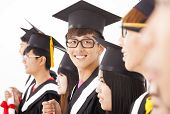 image of graduation  - asian male college graduate at graduation with classmates - JPG