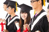 picture of classmates  - beautiful asian female college graduate at graduation with classmates - JPG