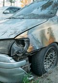 stock photo of combustion  - burned cars in the parking lot after the fire extinguishing wiring  - JPG