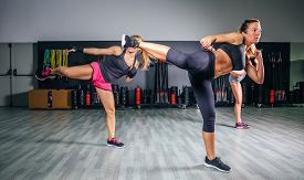 picture of boxing  - Group of beautiful women in a hard boxing class on gym training high kick - JPG