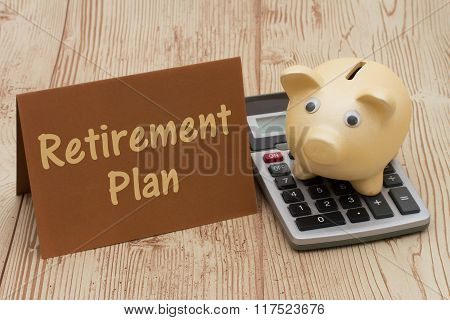 Having A Retirement Plan, A Golden Piggy Bank, Card And Calculator On Wood Background