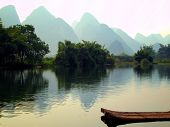 a raft and mountain on Yu Long river